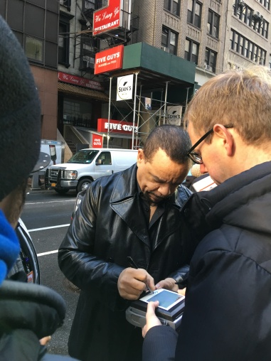 Here's the one guy in NYC that I'm more tech savvy then. - he's signing a polaroid picture!